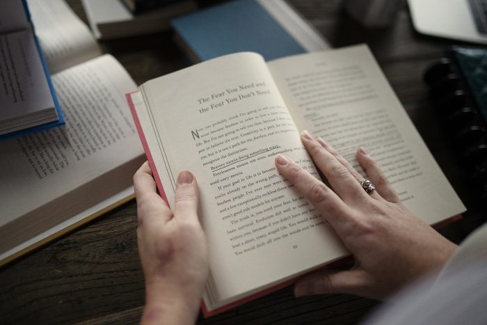 customer hands with finished book